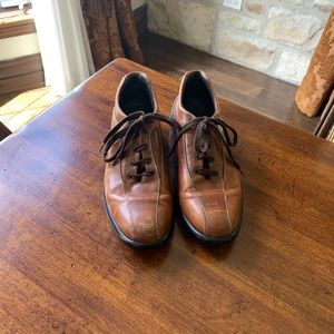 Tod's Brown Shoes...Scuff marks on it. Sold as is.